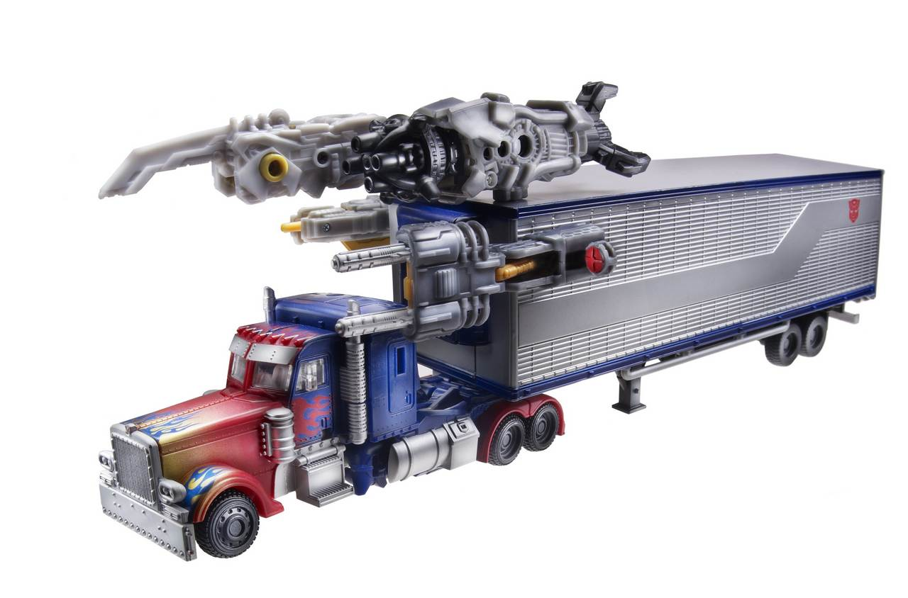 Optimus Prime with Trailer (Movie Trilogy) TF-Movie-All-Star-Optimus-w_trailer-vehicle-and-weapons-38840